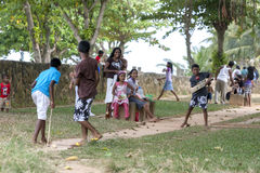 Children enjoy a game of cricket near Akersloot Bastion at Galle Fort in Sri Lanka. Royalty Free Stock Photos