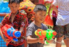 Children enjoy play water battle. During the Songkran festival at Buddhist temple in Bangkok on April 15, 2018 Stock Photography