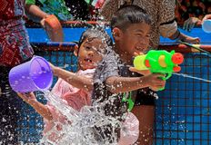 Children enjoy play water battle. During the Songkran festival at Buddhist temple in Bangkok on April 15, 2018 Stock Image