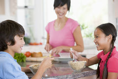 Children Enjoying Breakfast Stock Photo