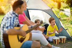 Children enjoying on camping in the tent Stock Photos