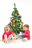 Children are enjoying the Christmas Tree Stock Photo