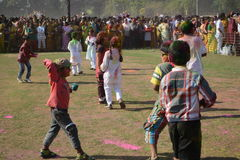 Children are enjoying Holi, the color festival of India. Everybody are full of colors. they are chasing each other to throw color. The festival of color at Stock Photos