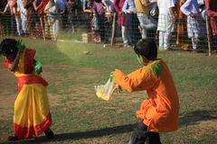Children are enjoying Holi, the color festival of India. royalty free stock images