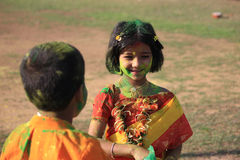 Children are enjoying Holi, the color festival of India. royalty free stock photography