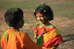 Children are enjoying Holi, the color festival of India. stock photo
