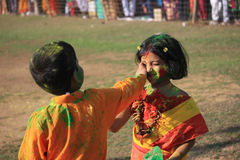 Children are enjoying Holi, the color festival of India. The festival of color at Shantiniketan, the abode of Rabindranath Tagore royalty free stock image