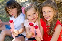 Children enjoying ice pops. Royalty Free Stock Images