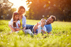 Children enjoying in making soap bubbles Stock Images