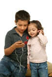 Children enjoying a mp4 player Royalty Free Stock Photography