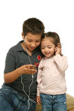 Children enjoying a mp4 player Stock Photo