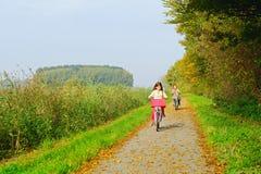 Children enjoying nature on bicycle Stock Photos