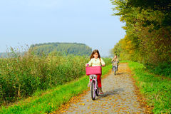 Children enjoying nature on bicycle Royalty Free Stock Images