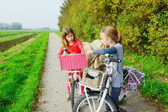 Children enjoying nature on bicycle Stock Images