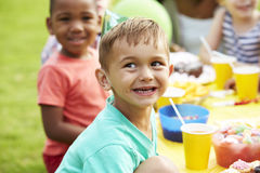 Children Enjoying Outdoor Birthday Party Together Royalty Free Stock Photo