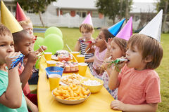 Children Enjoying Outdoor Birthday Party Together Stock Images