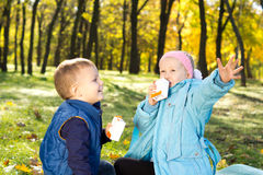 Children enjoying a refreshing drink Stock Images