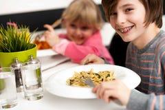 Children enjoying their meals Stock Images