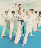 Children enjoying their trainings with coach at karate. Beautiful children enjoying their trainings with coach at karate classes Royalty Free Stock Images