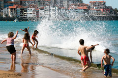 Children enjoying the waves Royalty Free Stock Photography