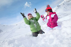 Children enjoying winter holidays in snowy mountains Royalty Free Stock Photography