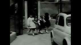 Children enter a gate stock video footage