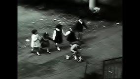 Children enter a gate stock video