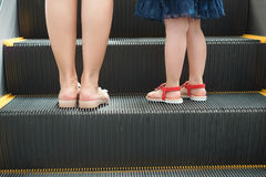 Children and escalator Royalty Free Stock Images