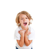 Children excited kid with happy winner expression. Isolated on white Royalty Free Stock Photo