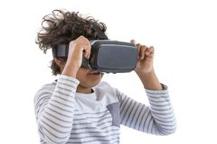 Children experiencing virtual reality video, game ,isolated on white . Surprised little boy looking in VR glasses. Royalty Free Stock Image
