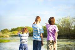 Children explore nature. Happy children royalty free stock photos