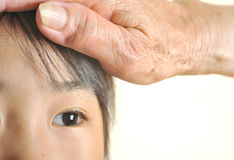 Children eye closeup with her grandmother care. Children eye closeup selective focus with her grandmother care. Happy asian eye little girl with wrinkle hand Stock Photo