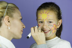 Children face painting. At the party royalty free stock images