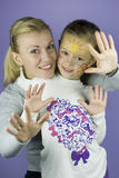 Children face painting Stock Photo