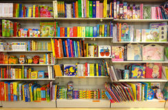 Children Fairy Books at Bookshop. Frontal view of shelf full of Italian colorful children fairy books in a bookshop at Aprilia2 Mall, Rome, Italy Royalty Free Stock Photography