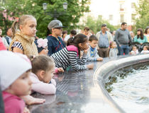 Children and Families Looking at a Fountain Stock Photography