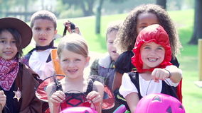Children In Fancy Costume Dress Going Trick Or Treating stock footage