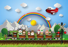 Children in fancy dress sitting on a train running on the tracks Stock Images
