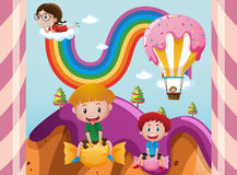 Children in fantacy land with candy Stock Image