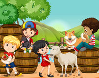 Children and farm animals Stock Images