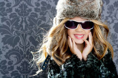 Children fashion blond girl winter season. Children fashion girl with fur winter coat Royalty Free Stock Photo