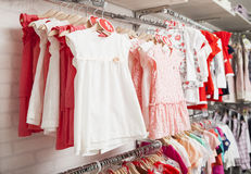 Children fashion clothing on hangers at the show Royalty Free Stock Photo