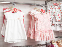 Children fashion clothing on hangers at the show Royalty Free Stock Images