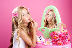 Children fashion doll little girl. Fashion little doll girl in pink vanity mirror with lipstick Stock Images