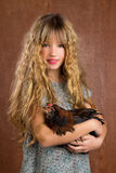 Children fashion farmer girl holding hen retro vintage Stock Photo