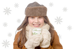 Children fashion girl with fur winter coat and cup of tea Stock Images