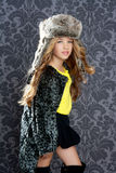 Children fashion girl winter coat and fur hat Royalty Free Stock Photos