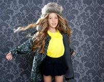 Children fashion girl winter leopard coat Stock Photo