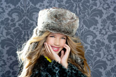 Children fashion girl with winter leopard coat Royalty Free Stock Photography