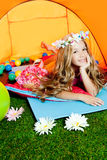 Children fashion little girl lying in camping tent Stock Photo